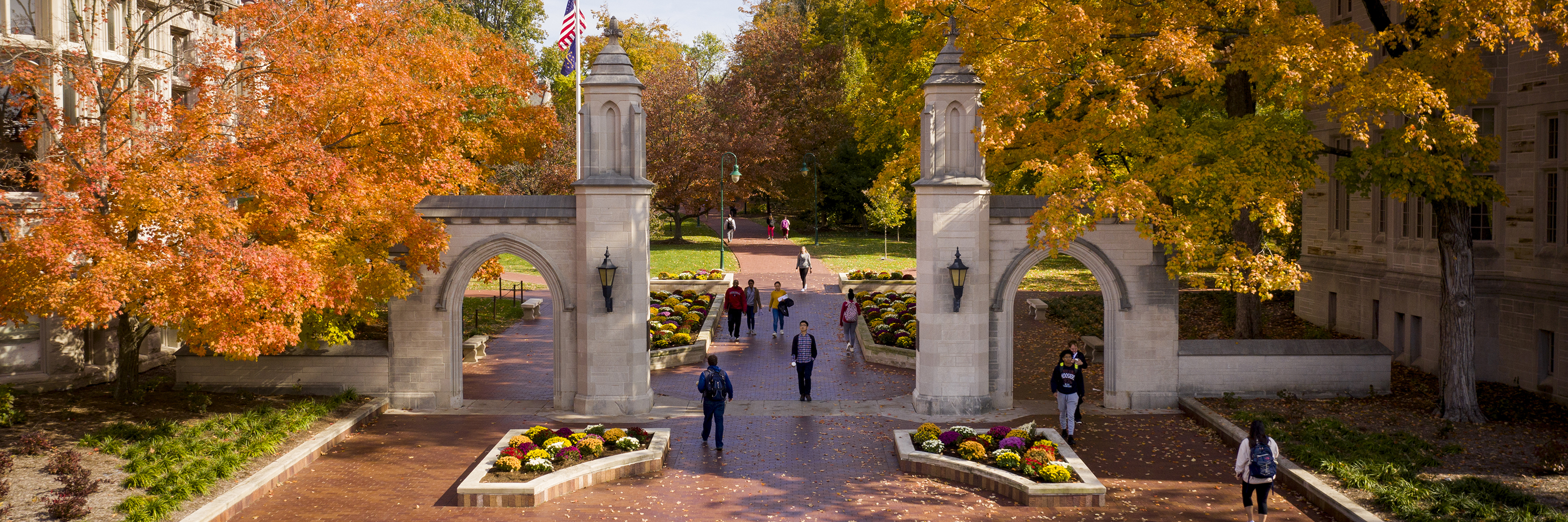 Students walk through the Sample Gates in the fall on the Indiana University Bloomington campus.